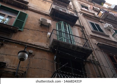 Vintage facade, windows with stutter, oldtown in Naples in south Italy