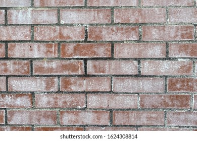 a vintage faded white washed red brick wall