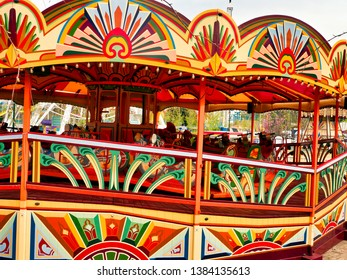 vintage fairground ride, brightly painted