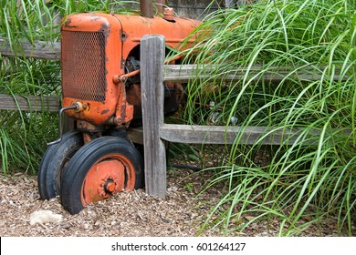 vintage farm tractor by wooden fence