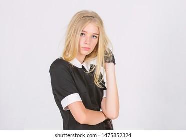 Vintage fashion concept. Girl blonde wear elegant black dress. Formal uniform elite school college or housemaid. Vintage model. Elegance in simplicity. Fashionable uniform. Vintage and retro style.