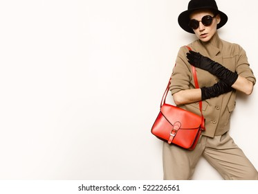 Vintage Fashion LadyBeige classic costume and stylish Accessories. Black Gloves. Glasses, Hat. Fashion concept. Glamor and retro. Autumn Winter trend