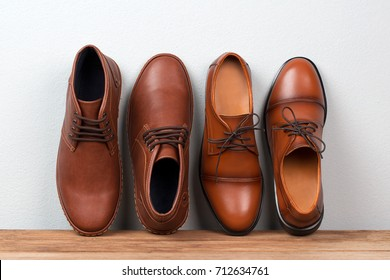6102933900303 Vintage fashion leather men shoes luxury design on wooden table.