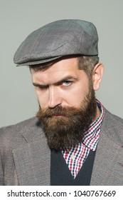 Vintage fashion - man in suit, shirt, waistcoat, cap. Fashionable bearded man. Elegant fashion man with beard, mustache dressed in stylish retro clothes. Confident bearded man in stylish retro clothes