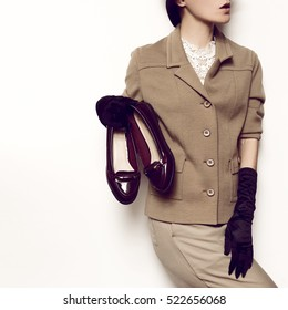 Vintage Fashion Model. Beige classic costume and stylish Accessories. Black Gloves. Hat. Fashion concept. Glam and retro. Trend Vintage Shoes