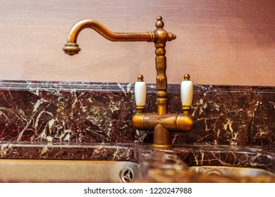 Vintage faucet on the sink. Washing dishes. Kitchen faucet. Sink in the kitchen.