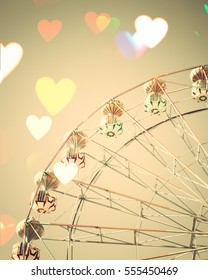 VIntage Ferris Wheel with bokeh hearts
