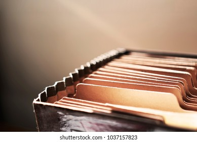 Vintage file folder close up with cinematic sunlight breaking in.