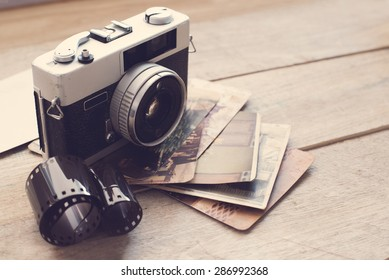 Vintage film camera on wood background with instagram retro filter effect