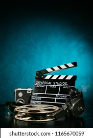 Vintage film claper with film reel and camera. filmmakers equipment background