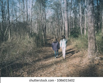 Vintage Film Look Shot of two sisters hiking in the woods of New Jersey on a sunny winter afternoon