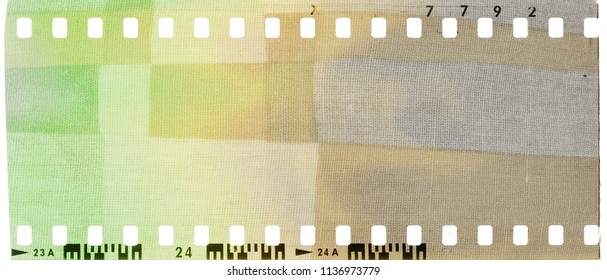 Vintage film strip frame with colorful fabric textured.
