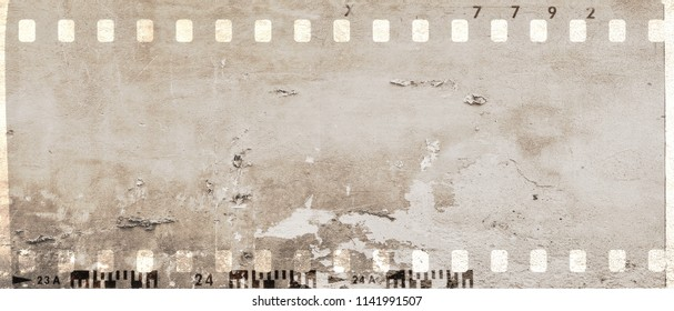 Vintage film strip frame with damaged and scratched wall surface. Sepia tones. Monochrome.