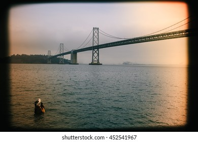 Vintage, film-style photo of the Bay Bridge, with light-leaks. San Francisco, California