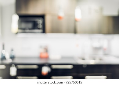 vintage filter of Blur background,Modern kitchen counter top with housewares appliances and bokeh light.