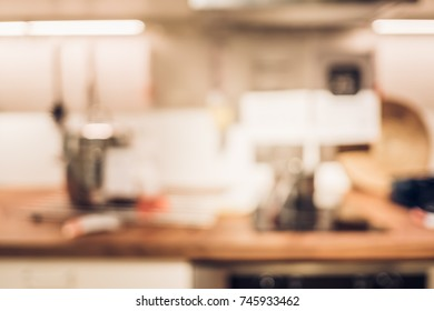 vintage filter of Blur background,Modern kitchen counter top with housewares appliances and bokeh light..