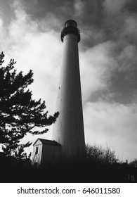 Vintage filter of old lighthouse with dark dramatic clouds moving in, storm coming