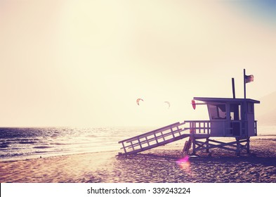Vintage filtered lifeguard tower at sunset with lens flare effect, USA.