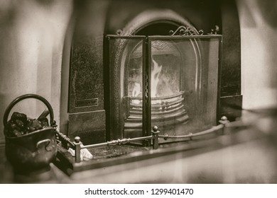 Vintage fireplace with marble surroundings fireside iron black bucket with coal in retro sepia style