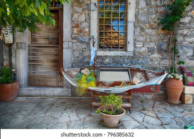 Vintage fish boat as a decoration in front of cafe in greek village, Crete, Greece.