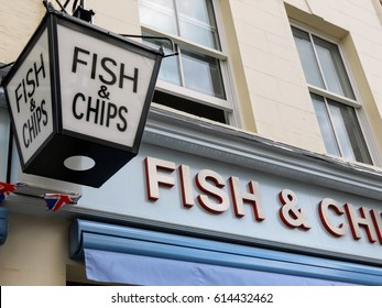 Vintage Fish and Chips sign outside a restaurant in London, England