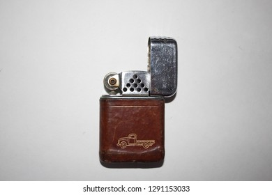 vintage flip top lighter with flatbed truck image isolated on white