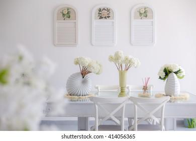 Vintage flower vase on the table.