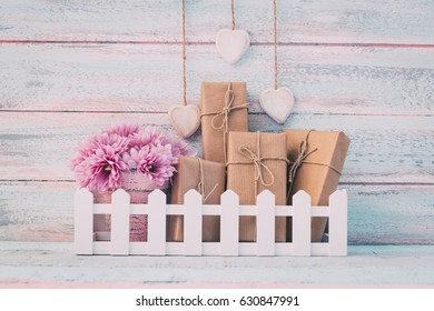 Vintage flowers and gift boxes on shabby chic background
