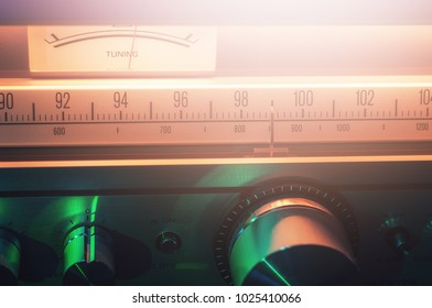 Vintage FM radio tuner with scale and volume meter closeup shot