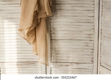 vintage folding screen with cloth in morning lights