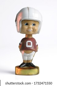 A vintage football player bobble head doll.