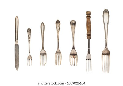 Vintage forks and knife isolated on white background