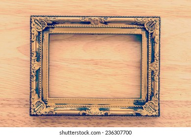 Vintage frame on wooden background process vintage style picture