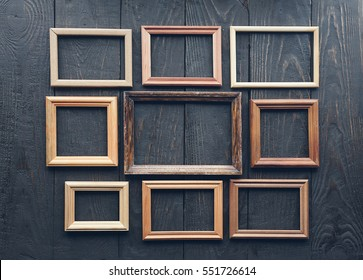 vintage frames on old wooden wall.
