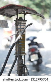 Vintage fuel station with dispenser in the street of the Vietnamese city
