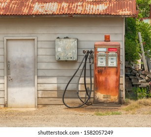 Vintage gasoline fuel pump looking distressed in rural Australia.