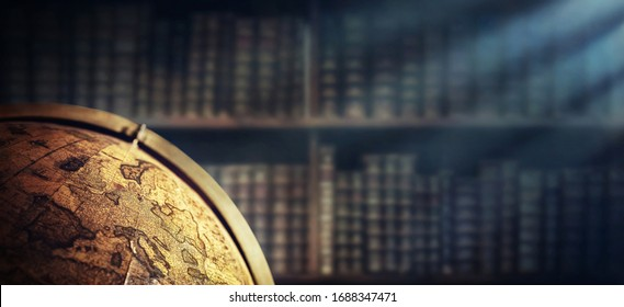 Vintage geographic globe on the background of bookshelves. Science, education, travel, vintage background. History and geography team.