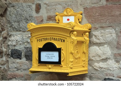 vintage german letterbox mounted on a wall