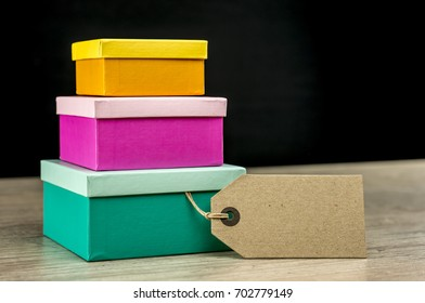 Vintage gift tag on colorful nesting gift boxes
