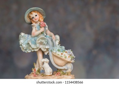 Vintage Girl Figurine wearing petticoat with bunny