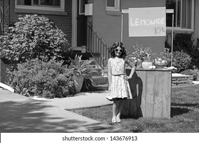 vintage girl with lemonade stand in black and white