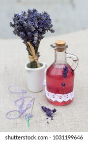 vintage glass bottle with natural lavender syrup and a bouquet of lavender
