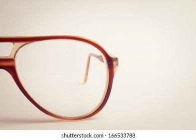 vintage glasses on dullisolated background