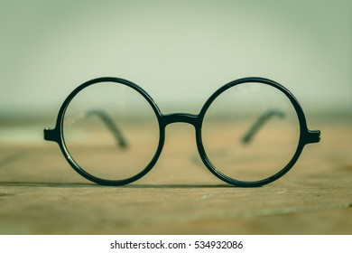 Vintage glasses on a wooden table.