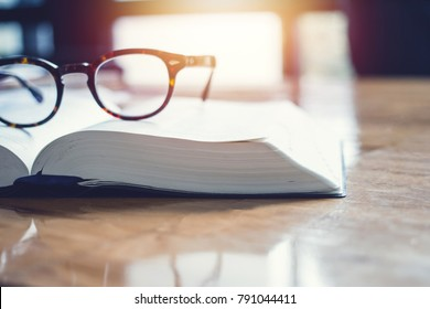 vintage glasses,on books stack in public library book, Studying examining. Tutor books with friends. Young students campus helps friend catching up and learning. People, learning, education