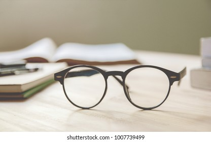 vintage glasses,on table in Studying examining. Tutor books with friends. Young students campus helps friend catching up and learning. People, learning, education