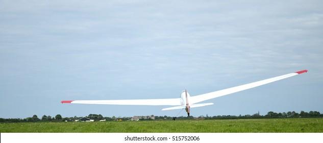 vintage glider on takeoff