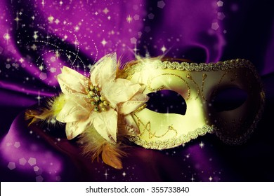 Vintage gold carnival mask on a dark background.