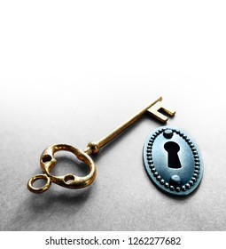 vintage gold key and old lock closeup