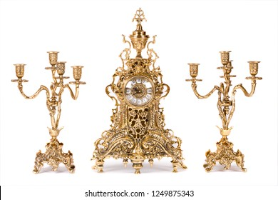 Vintage gold watch with candelabra on white background
